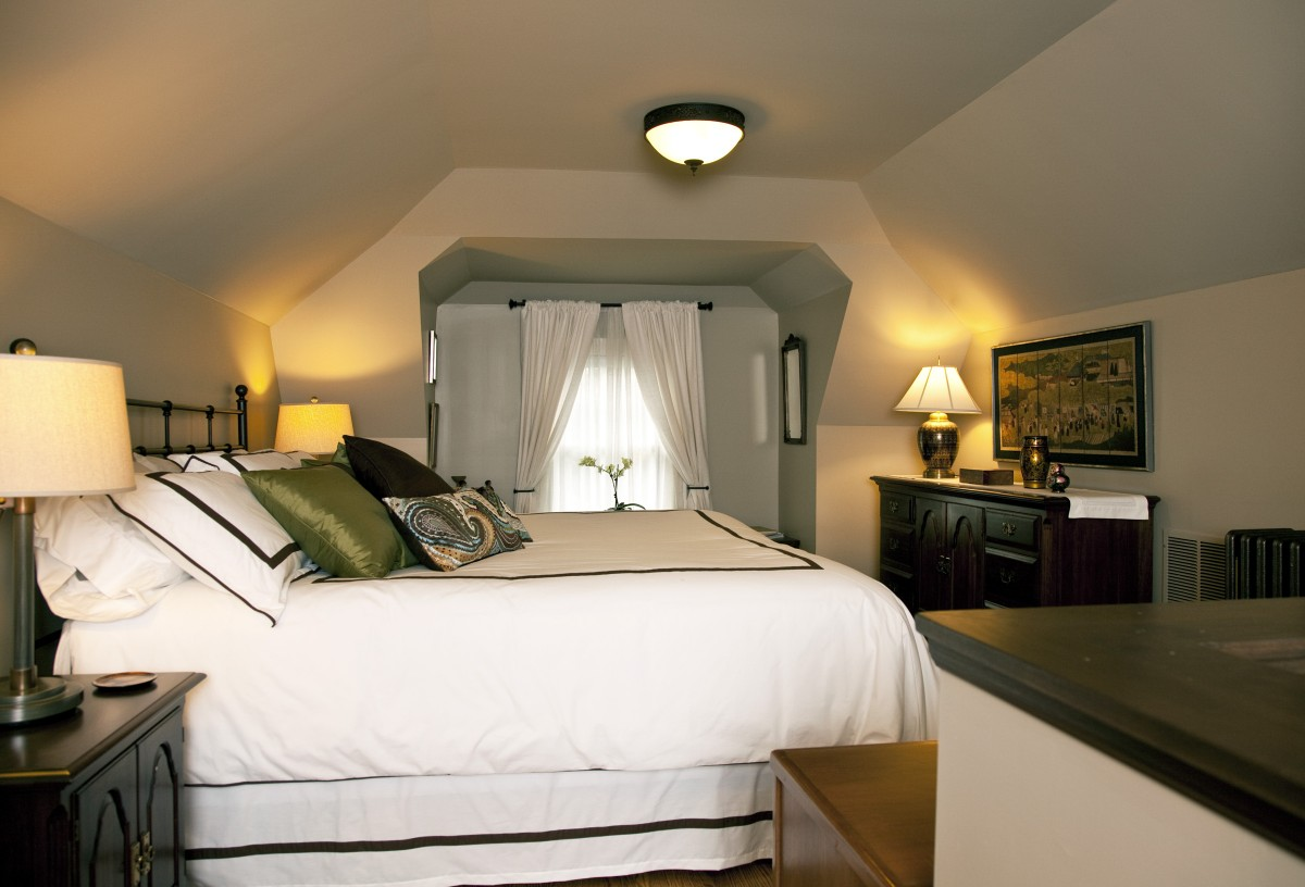 Prior to the remodel, the attic space was used as storage. Old carpet was torn up, revealing hardwood floors, new millwork was installed, and walls and ceilings were repaired and refreshed. Now it is a beautiful and welcoming guest bedroom.