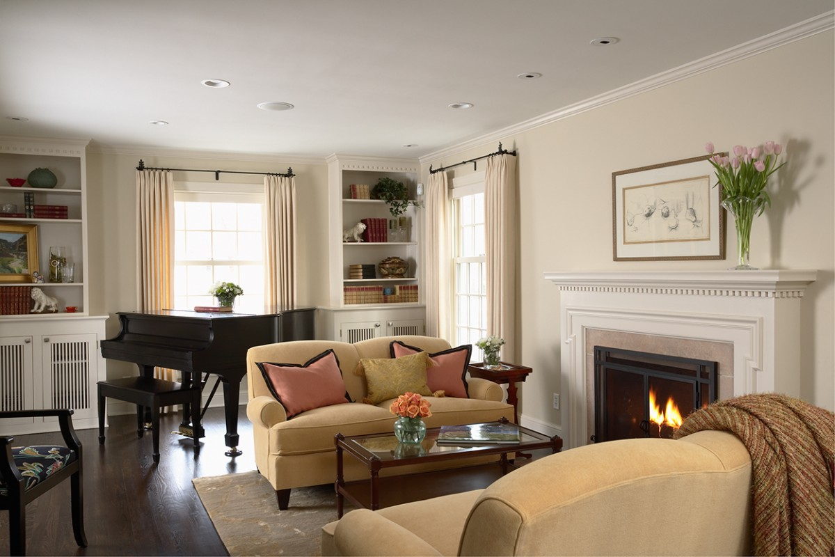 <p>This home was completely renovated, including an addition. It was transformed from a Colonial style to Greek Revival, which was more fitting for the neighborhood. The living room now feels comfortable and light.</p>