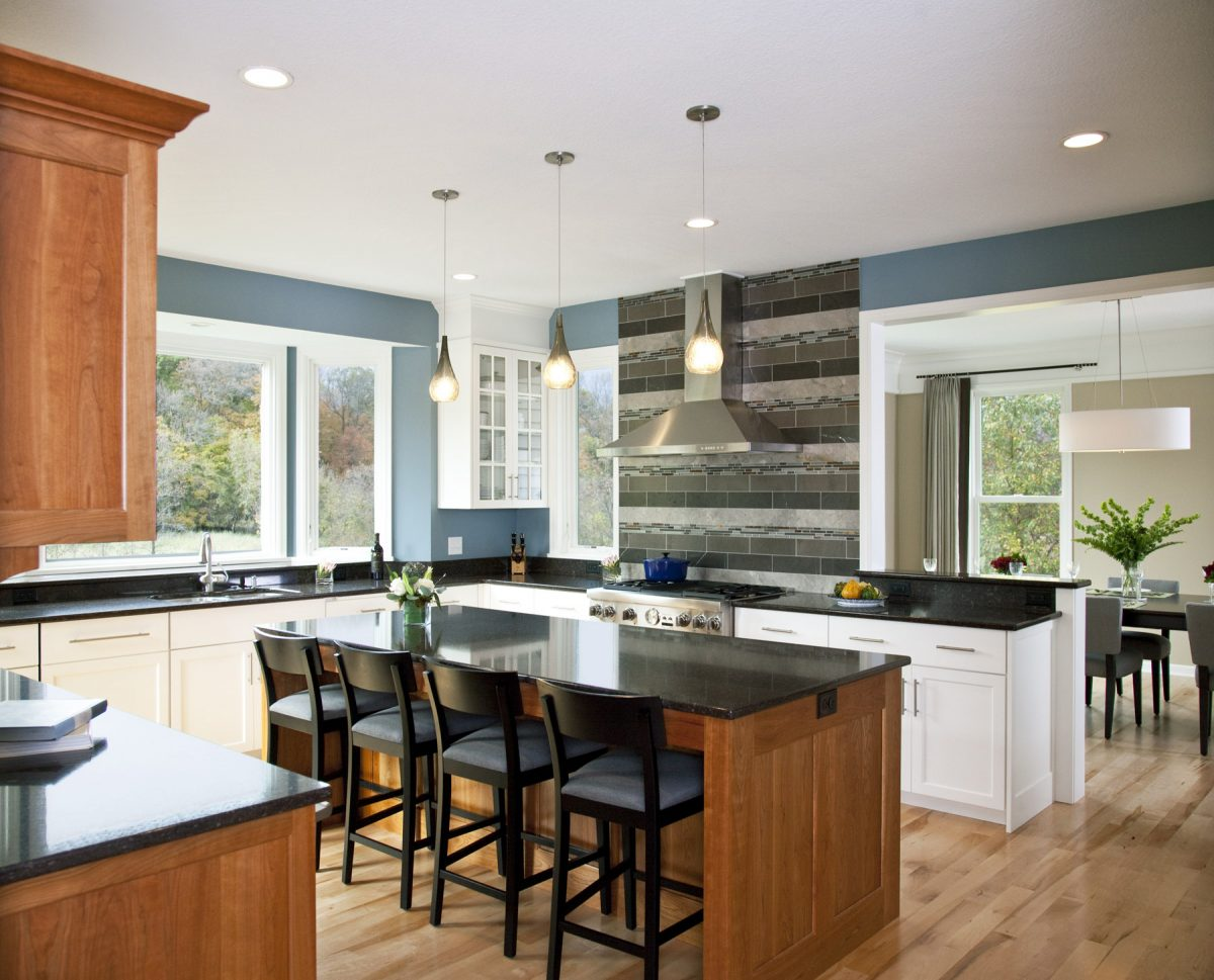 <p>TreHus opened the kitchen up to the living and dining rooms, and replaced builder grade maple cabinetry, laminate counter tops, and stone veneer with custom cabinetry, Cambria countertops and ceramic tile. The remodel redefined the character of the home, mixing traditional architectural styles with a few modern twists.</p>