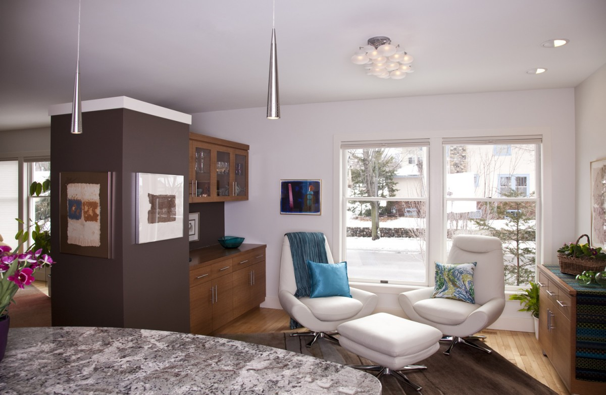 Here is the remodeled living room, with the new hutch with horizontal-grain oak to match the kitchen. A funky, contemporary light fixture adds to the contemporary aesthetic.