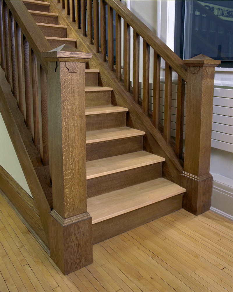 <p>A closeup of the quartersawn oak staircase, with a detailed newel post.</p>