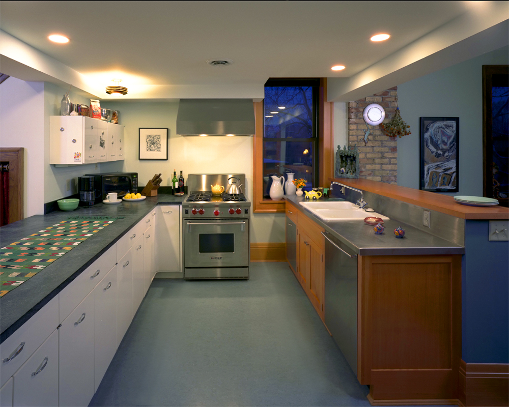 <p>The kitchen, where the original metal cabinets from the space's time as a masonic lodge have been reused.</p>