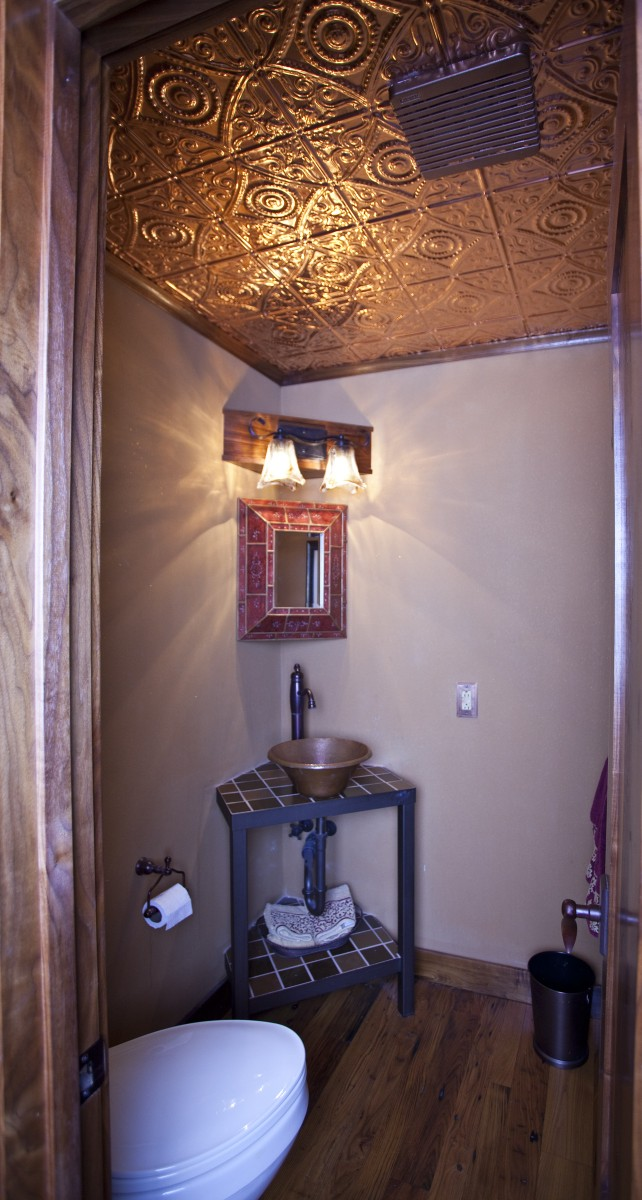 <p>This powder room was the first project TreHus did at this home.  It has walnut trim, and a copper ceiling and sink.</p>