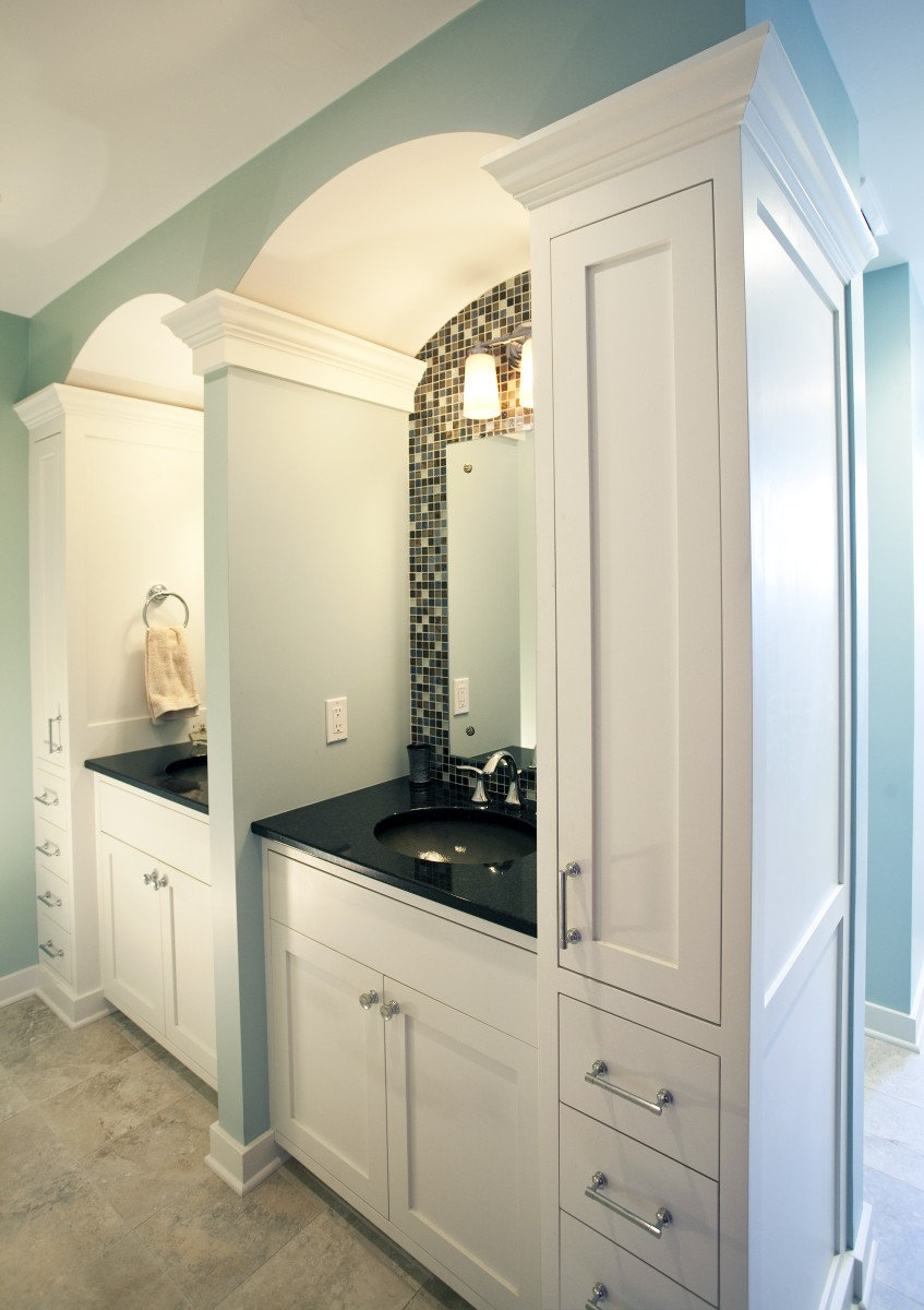 <p>In addition to the master bathroom, TreHus remodeled this bathroom for the owners' daughters.  The bathroom is set up so that they each have their own vanity with a partition between the two, as well as lots of storage.  Classy features like the tile backsplash, undermount sink, crown molding, and curved ceiling abound.</p>