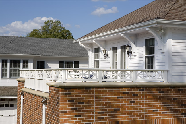 <p>French doors open from the master suite onto this second story deck over the garage.</p>