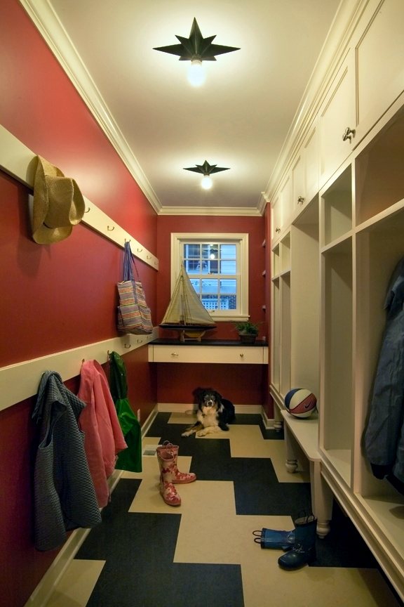 <p>A mudroom with custom cabinetry and plenty of coat hangers gives children a place to take off and store muddy boots and jackets.</p>
