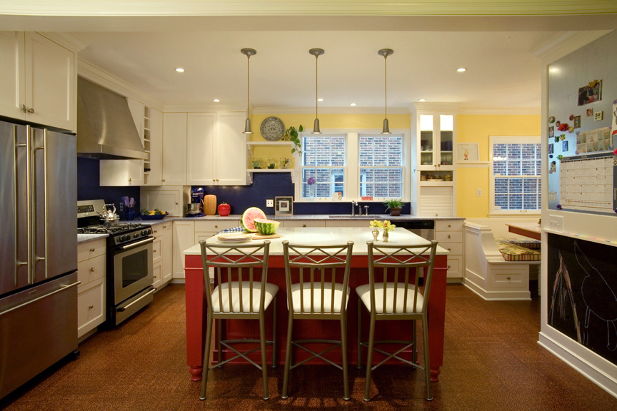 The owners of this 1941 brick colonial home wanted to remodel their home in as ecologically responsible a manner as possible. Existing energy efficient appliances, lights and plumbing fixtures were repurposed throughout the home. Rooms are happily painted with lots of red, yellow, violet and blue, all in low VOC paint. The kitchen countertops are recyled class and paperstone, and the floor is cork.
