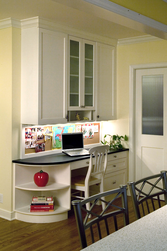 A custom desk is built into a corner of the kitchen.