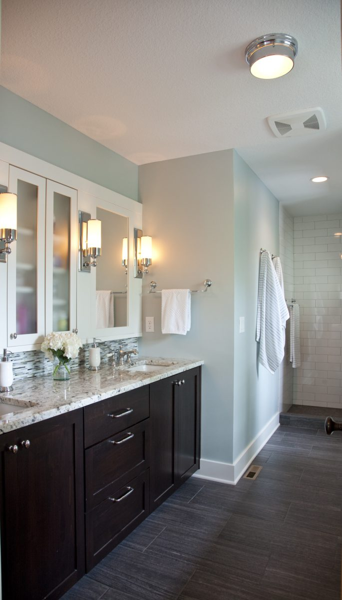 The master bathroom features  dark-stained clear alder custom double-vanity, a whirlpool tub, and a large shower.