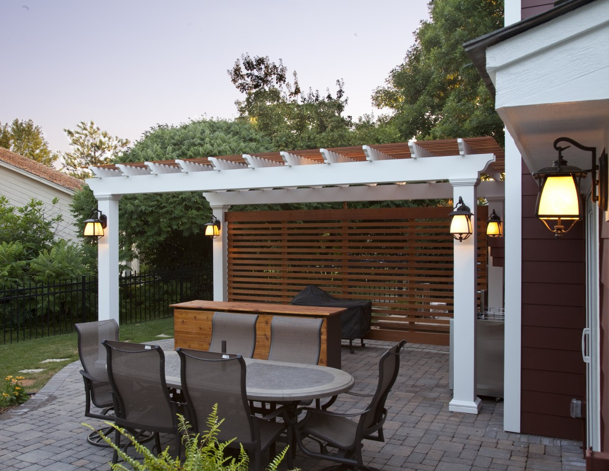 The owners are avid entertainers and wanted an outdoor space for their guests to congregate.  The pergola provides shade and defines an area for serving and preparing food.