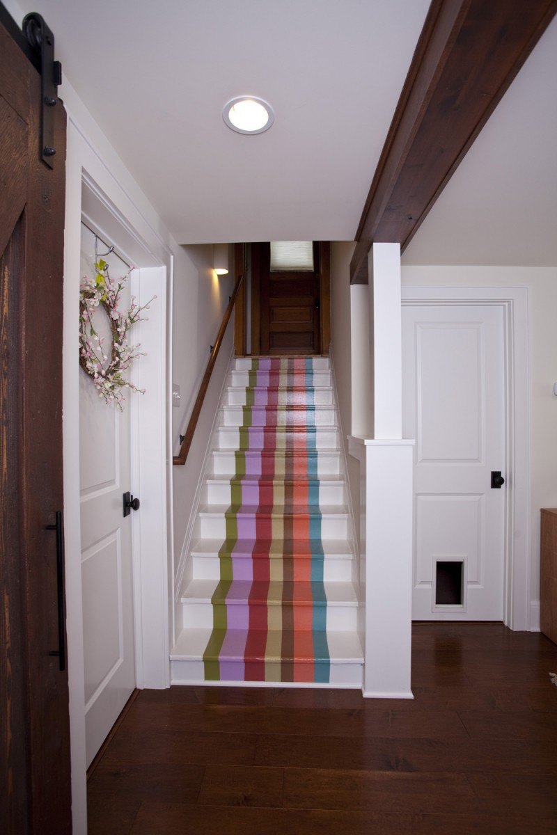 The staircase – painted with rainbow stripes.