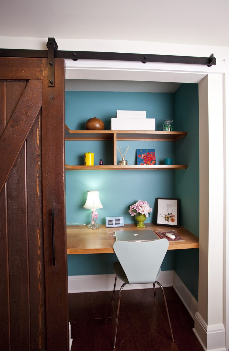 The barn door slides open to reveal this built in desk.