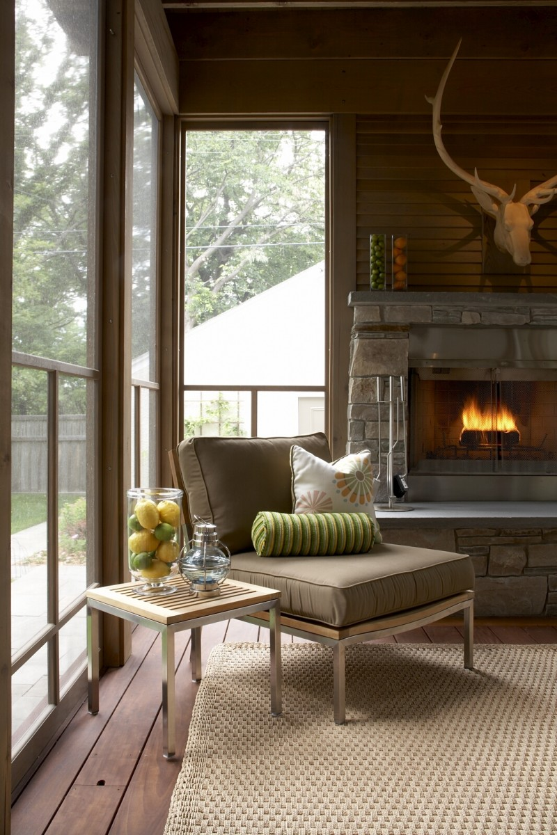 "This handsomely crafted porch extends the living area of the home's den by 250 square feet and includes a wood burning fireplace faced with stone. The Chilton stone on the fireplace matches the stone of an existing retaining wall on the site. The exposed beams, posts and 2"" bevel siding are clear cedar and lightly stained to highlight the natural grain of the wood. The existing bluestone patio pavers were taken up, stored on site during construction and reconfigured for paths from the house around the porch and to the garage. Featured in Better Homes & Gardens and the Southwest Journal."