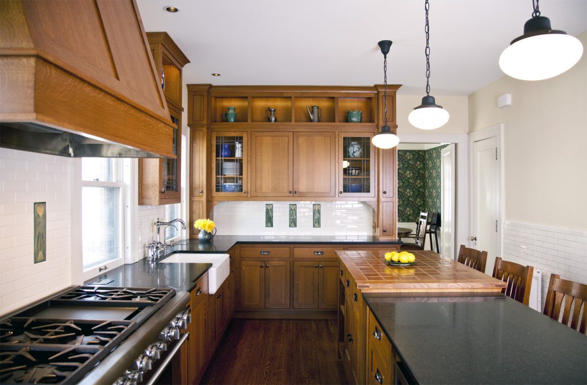 <p>The owners of this 1919 craftsman home in Tangletown desired to infuse their kitchen with the old-world character that they loved in the rest of their home. Taking their cue from an antique Stickley island they had previously purchased, our design team created a remodeled kitchen with custom quartersawn oak cabinets, custom-designed, handmade accent tiles, and a farmhouse sink.</p>
