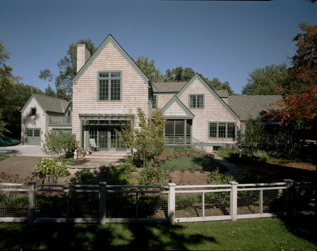 This beautiful home near Lake of the Isles was completely gutted and remodeled. On the exterior, stucco was replaced by cedar shakes, and a large addition was built. The interior was beautified and updated throughout, with white woodwork, warm natural materials, and lots of interesting architecural details.