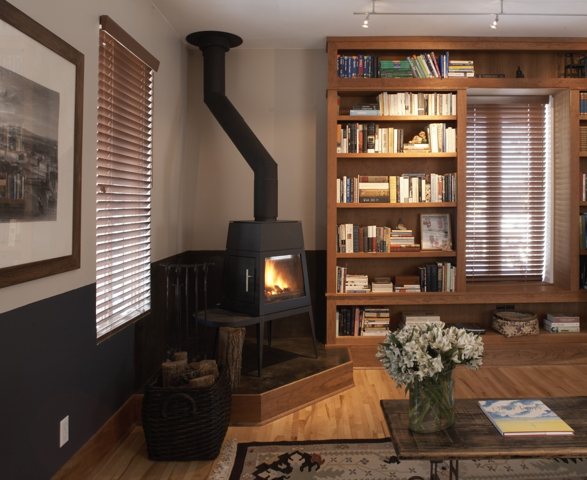 This project includes great spaces for enjoying the outdoors or staying cozy inside. The family room is warmed by cherry bookshelves and a fireplace, while the sunroom and second-story deck provide a connection to the outdoors.