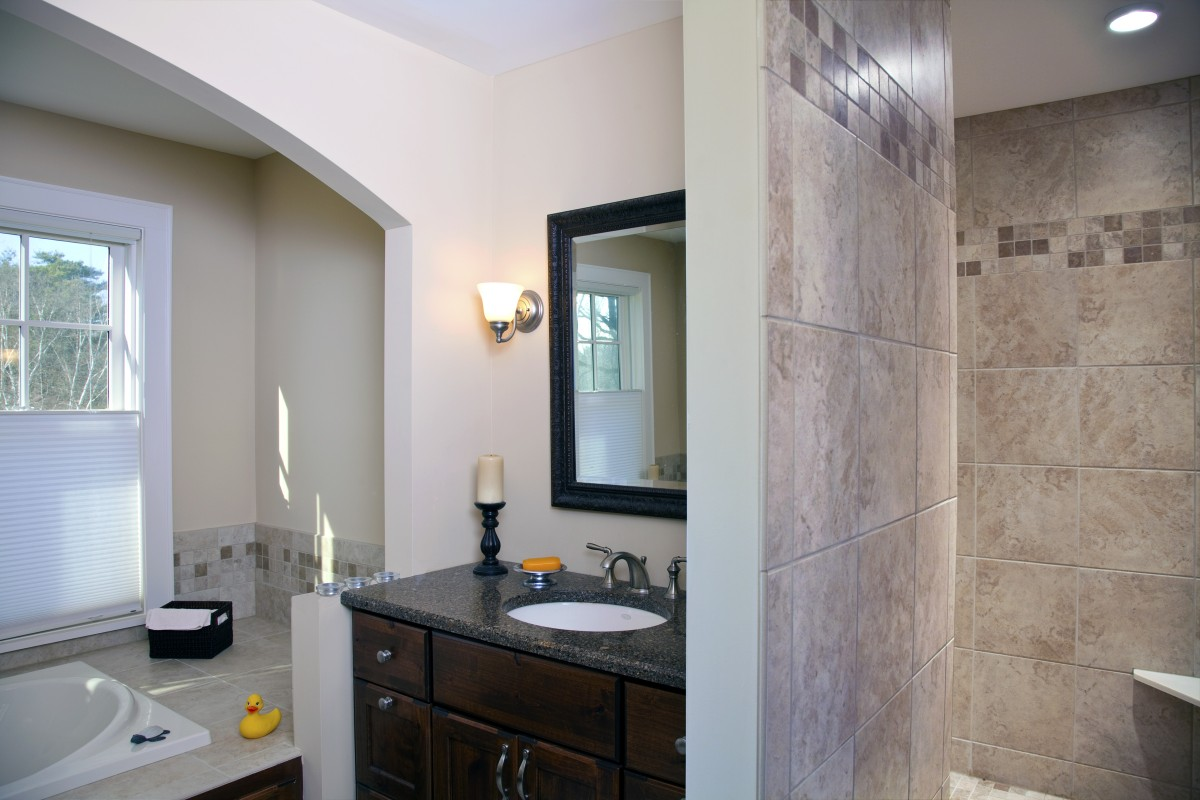 <p>The master bathroom features dueling vanities and a large shower.</p>