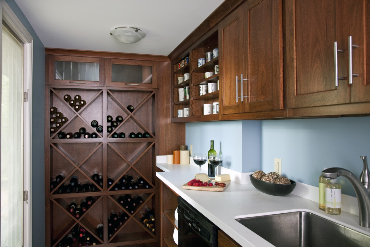 This pantry was built with entertaining in mind. It gives the owners an extra dishwasher, more counter space, an additional sink, more storage, and dedicated storage for their wine. It makes entertaining easier and provides more surfaces and tools for cleanup.
