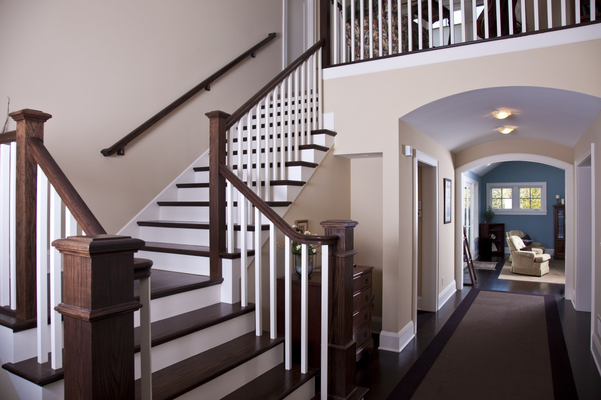 <p>Upon entering the home, one is greeted by this two-story foyer, with a beautiful oak staircase and open views of most of the first floor.</p>
