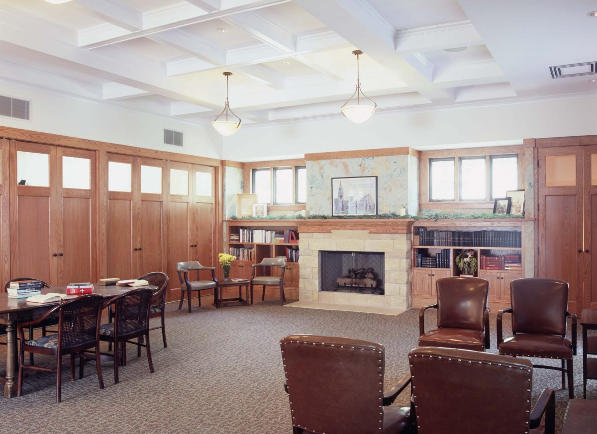 <p>This meeting area adjacent to the fellowship hall was renovated with plenty of storage, seating areas, a beautiful coffered ceiling, and a large central fireplace.</p>