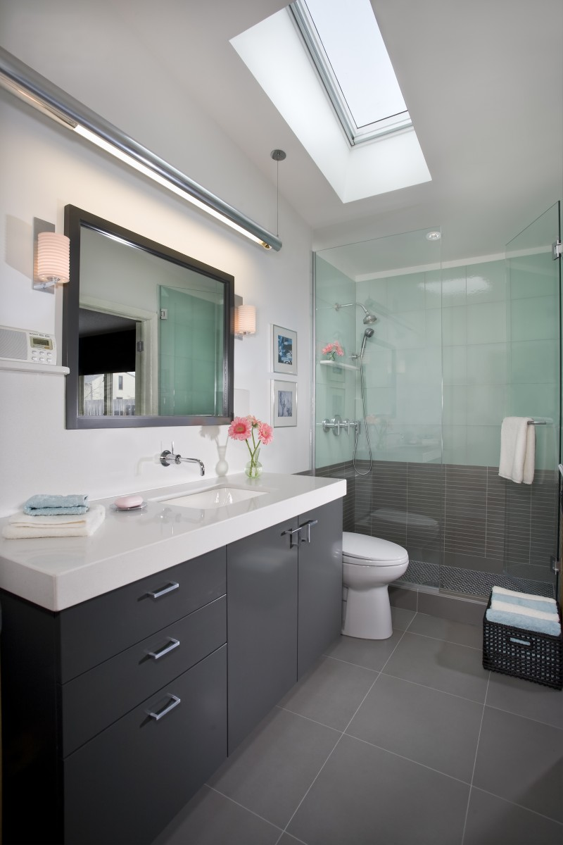A spacious glass-enclosed shower, custom vanity and Caesarstone counter top combine to give this bathroom a clean, modern aesthetic.
