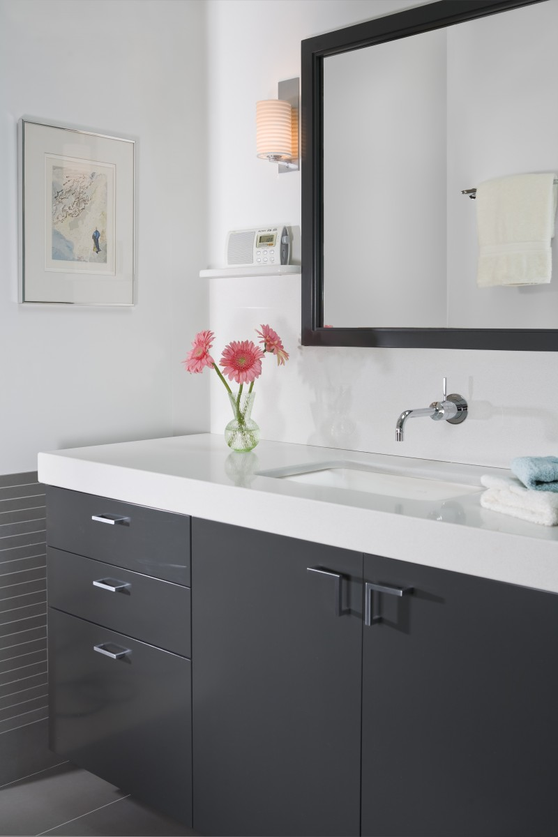 <p>A spacious glass-enclosed shower, custom vanity and Caesarstone counter top combine to give this bathroom a clean, modern aesthetic.</p>