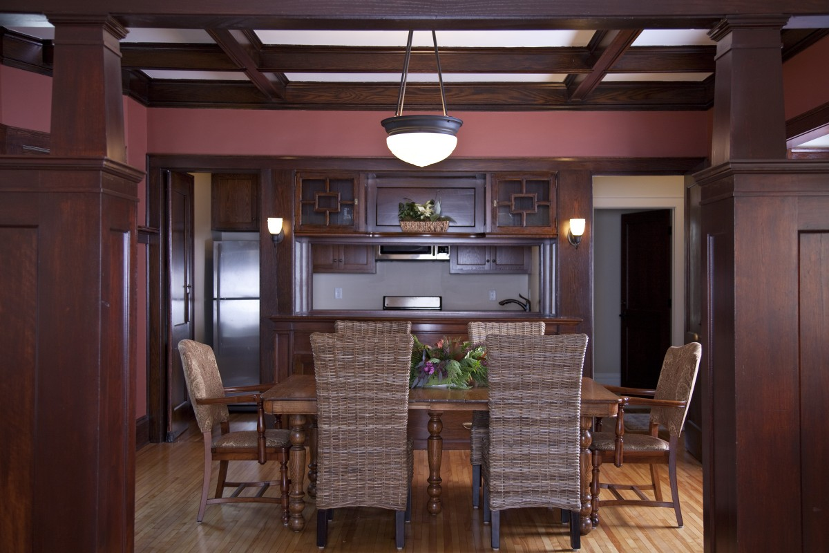 <p>This dining room on the second floor still had beautiful original woodwork, which we saved, repaired and refinished.  It now serves as a waiting area for families of the women who are giving birth.</p>