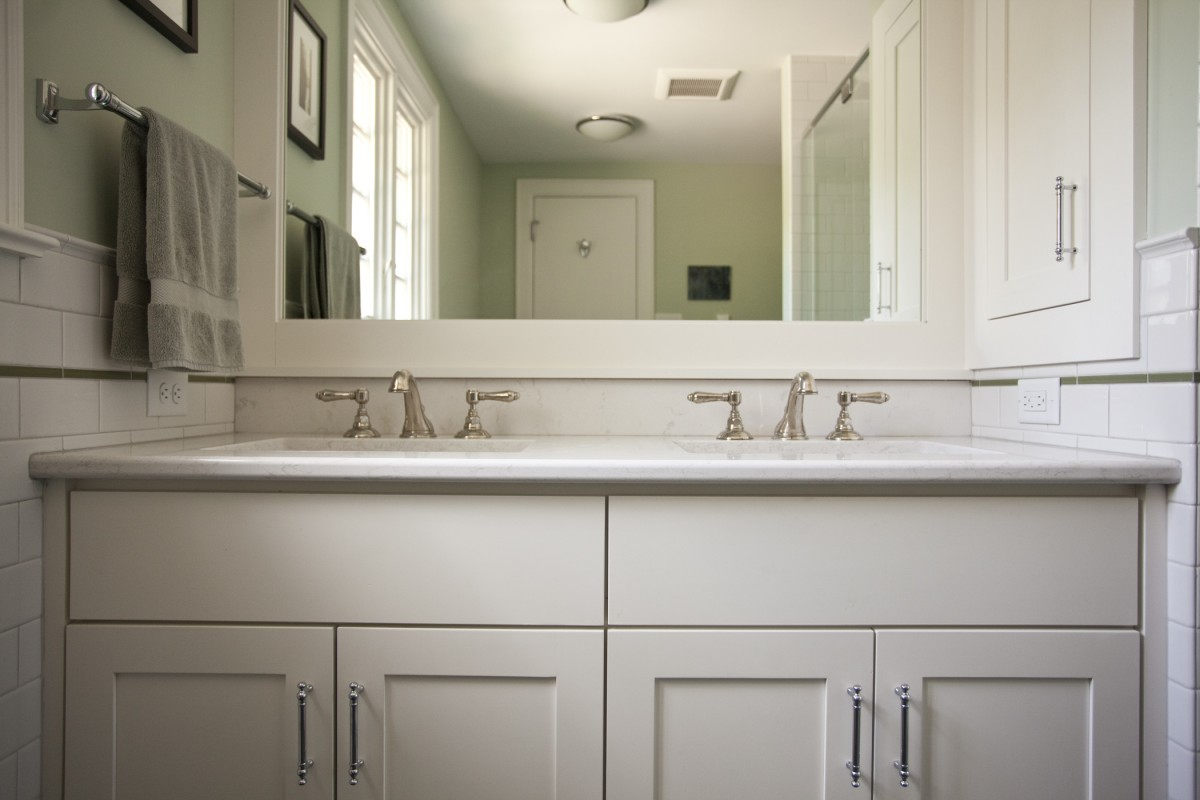 This shot shows how the vanity top, mirror, medicine cabinet and tile wainscoting all fit together. There are a lot of intersections here – the goal is to make them look symmetrical, simple, clean and beautiful.