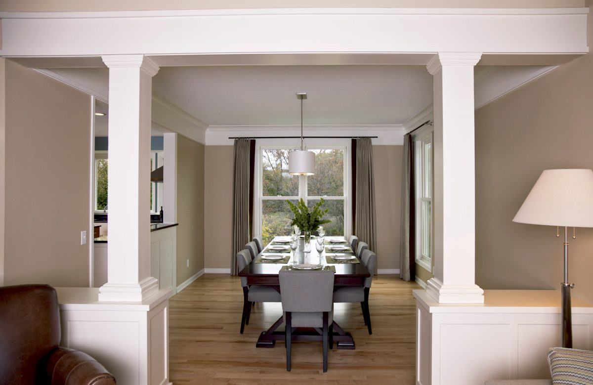 <p>The dining room was slightly enlarged to make room for entertaining larger groups. A new window was added, and sight lines to the kitchen were opened. Woodwork was replaced, and new maple floors were added to match other areas of the first floor.</p>