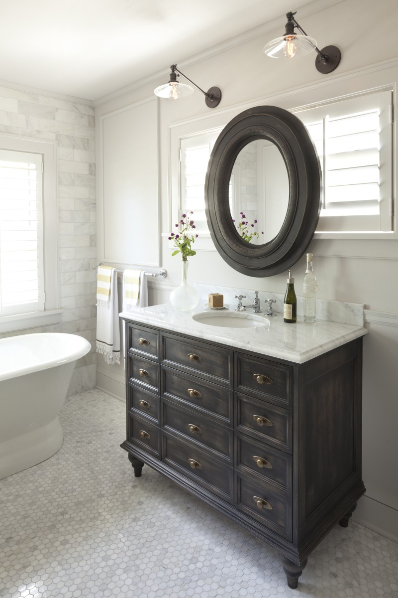 Here's a closeup look at one of the master bath vanities, which features a carrara marble top and a distressed finish.