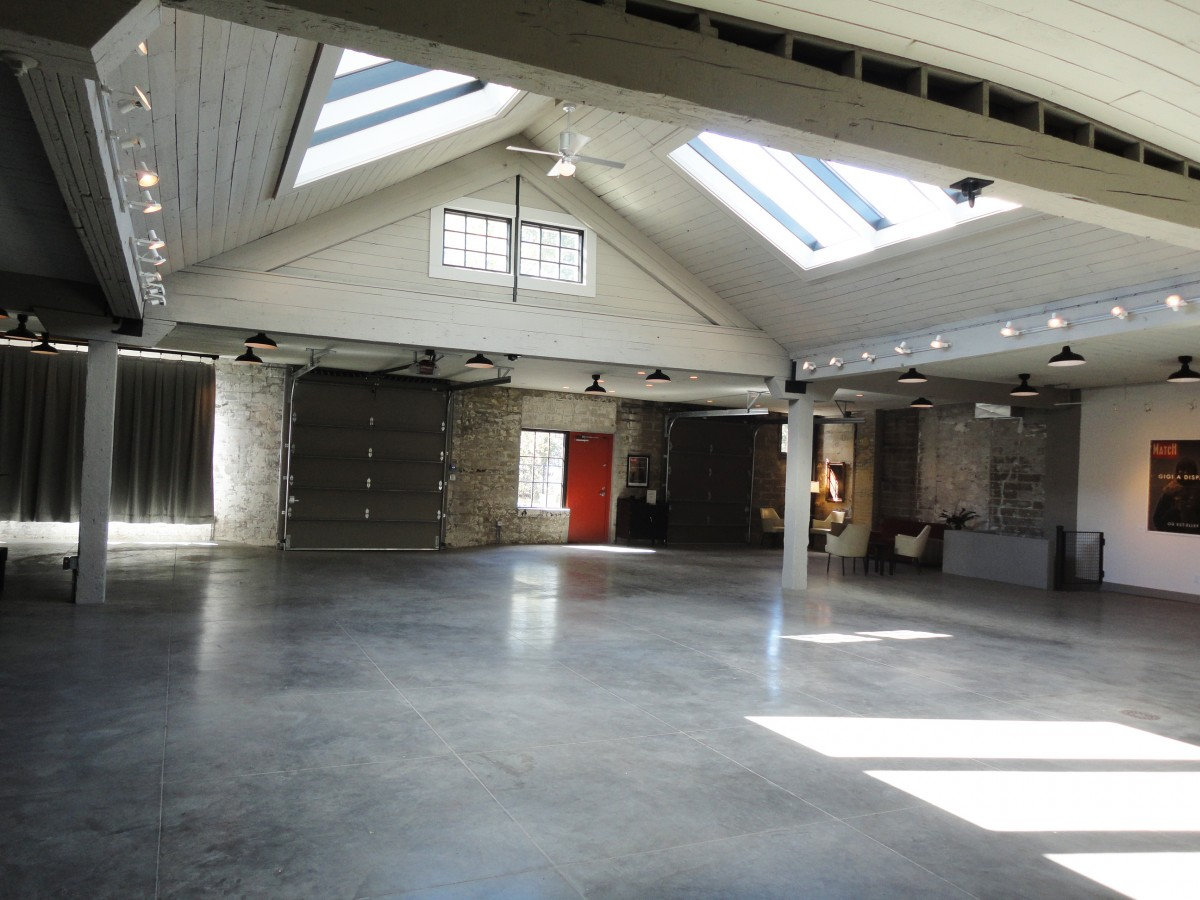 <p>The building is split into two halves – this side is an expansive open space with a vaulted ceiling.  Old skylights that had been covered up were rebuilt, and the wood-covered ceiling was restored.</p>