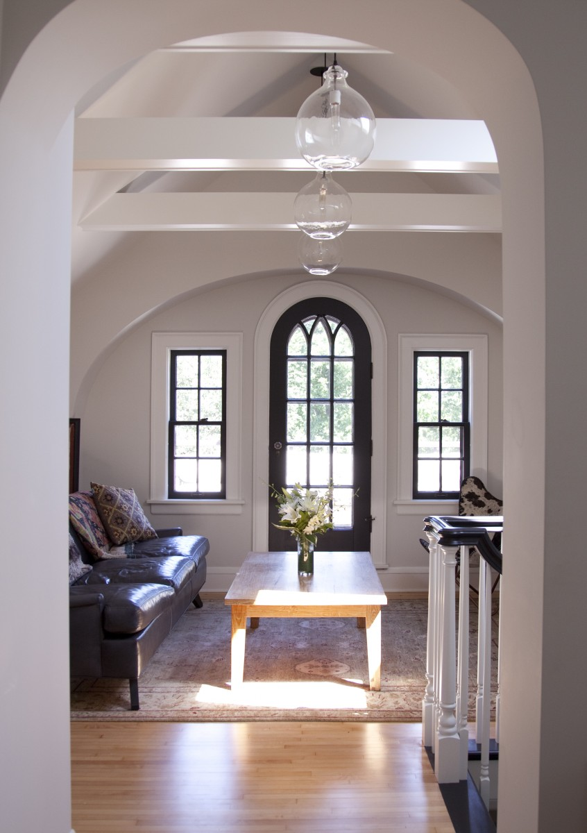 <p>A new vaulted ceiling dramatically transformed the attic's lounge area.</p>