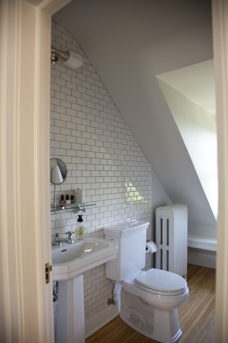 A tucked-awayattic bathroom was given a clean, fresh look.