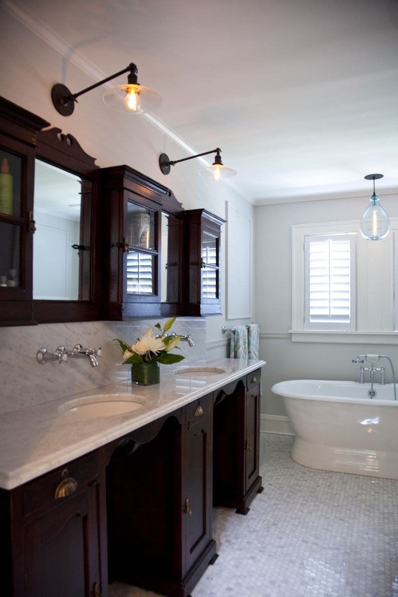 An antique barber's cabinet was given new life asthe vanity in thesecond floor bathroom.