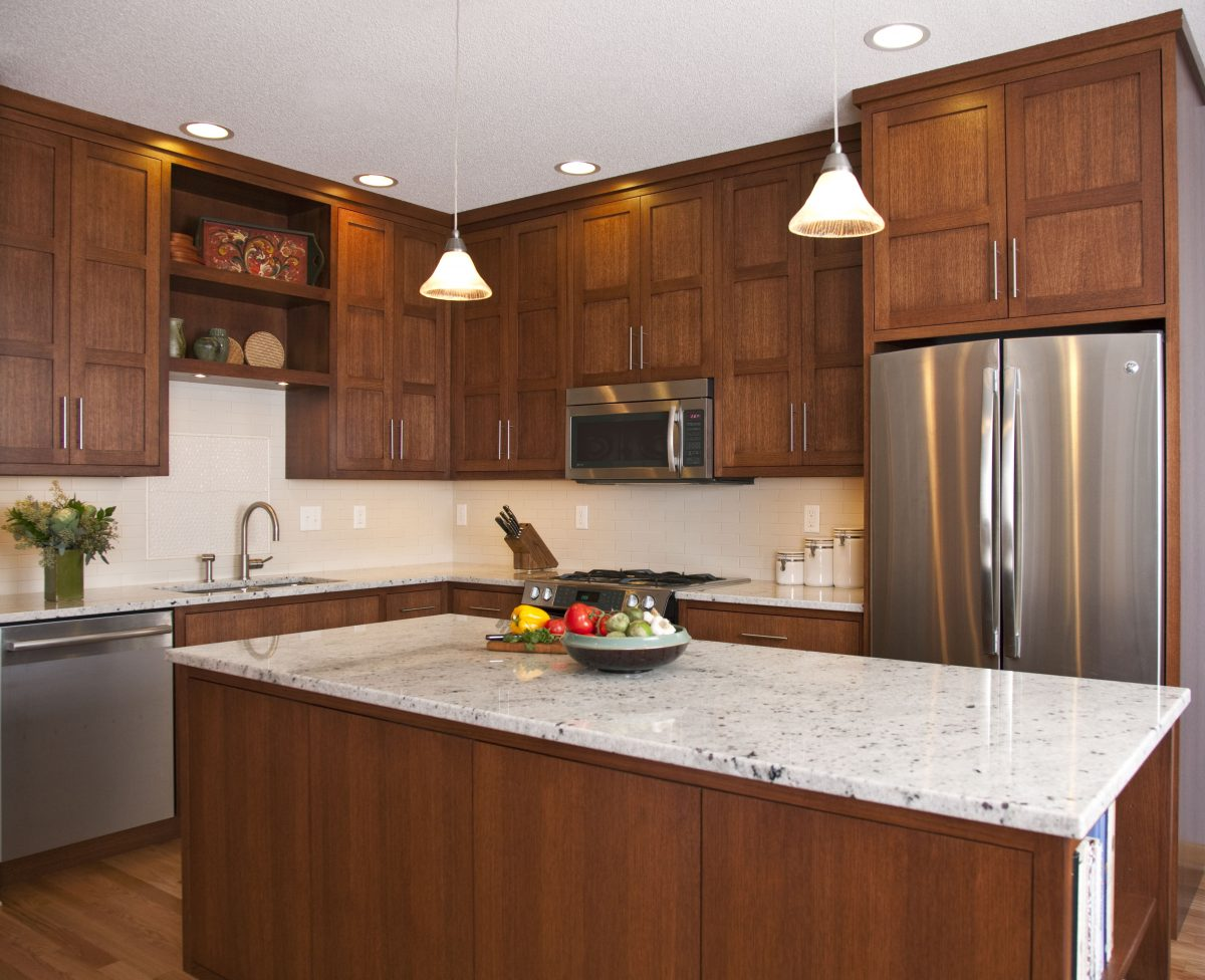<p>In this condo kitchen, the beautiful vertical graining of rift-cut white oak is truly a work of art. Pairing a paneled door style on the uppers with a more modern slab door on the lower cabinetry reflects the owner's sophisticated style.</p>