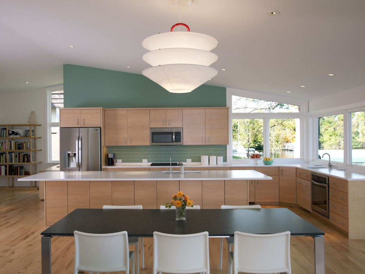 <p>This Lake Minnetonka kitchen was designed to take full advantage of the beautiful view. The aqua wall, matching backsplash tile and light maple cabinetry echo the home's tranquil lakeshore feeling.</p>