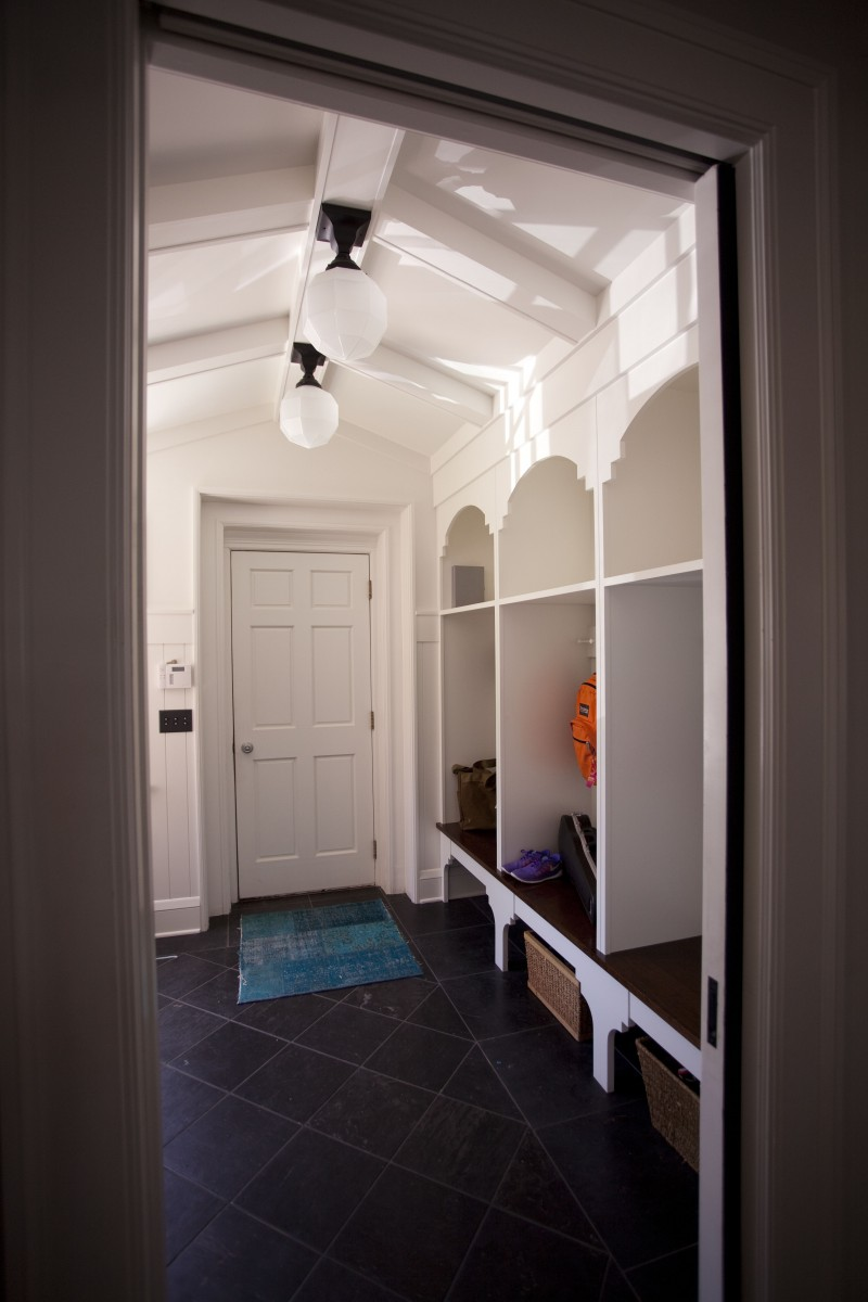 A new mudroom complete with large bench and lockers was added off the garage, ultimately creating a more open entry.