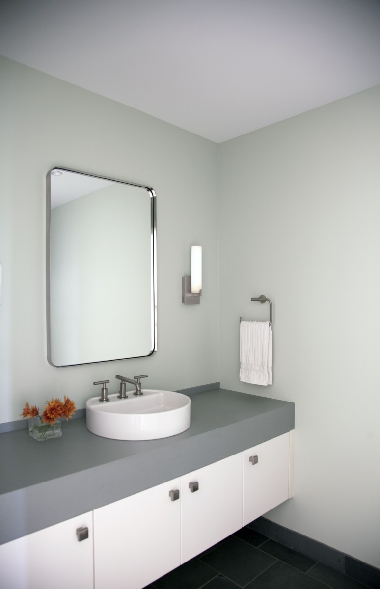 The bathrooms feature clean design and a relaxed color palette, working in harmony with the rest of the home.