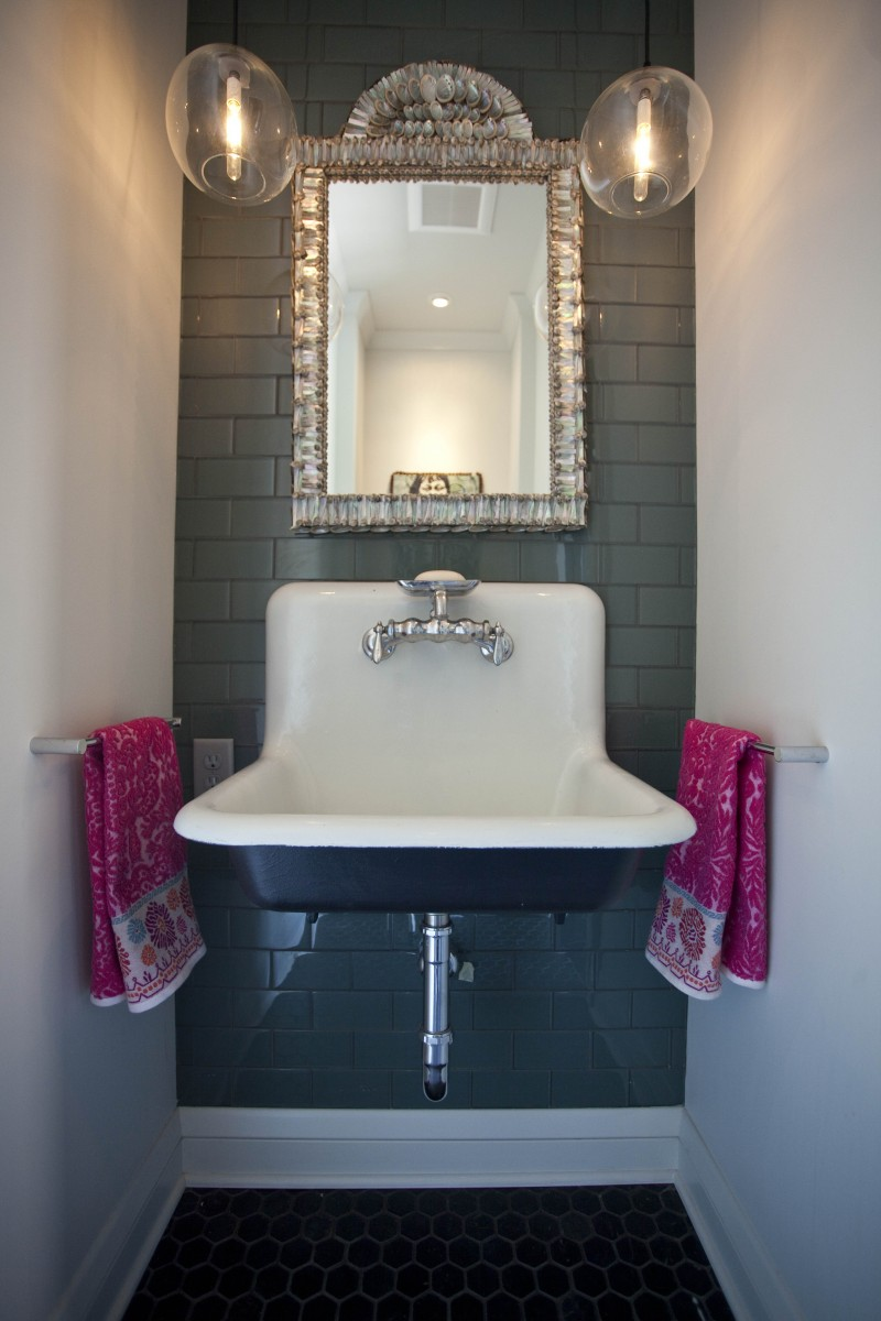 A small powder room was relocated on the main floor.
