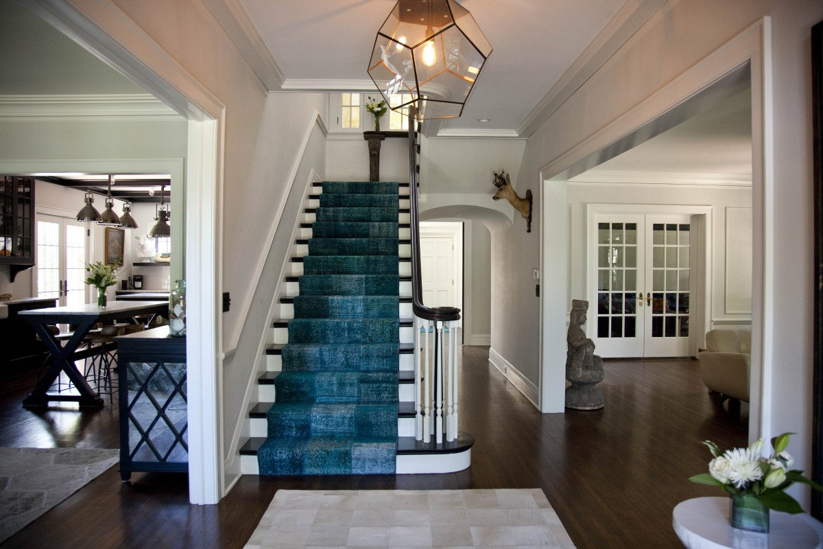 This grand home on Lake Harriet was blessed with gracious rooms and details, but had tangled circulation, and lacked the spaces suited to a 21st century family.To solve this without a new addition, we relocated stairways, improving the flow and freeing up enough space to gain a mudroom, a generous kitchen, and room to move furniture into the attic.Creative strategies, including opening the floor beneath a dormer, increased the amount of daylight, and improved views without adding new window openings.The more modern floor plan is paired with details and materials consistent with the original home, gracefully blending the new with the old.