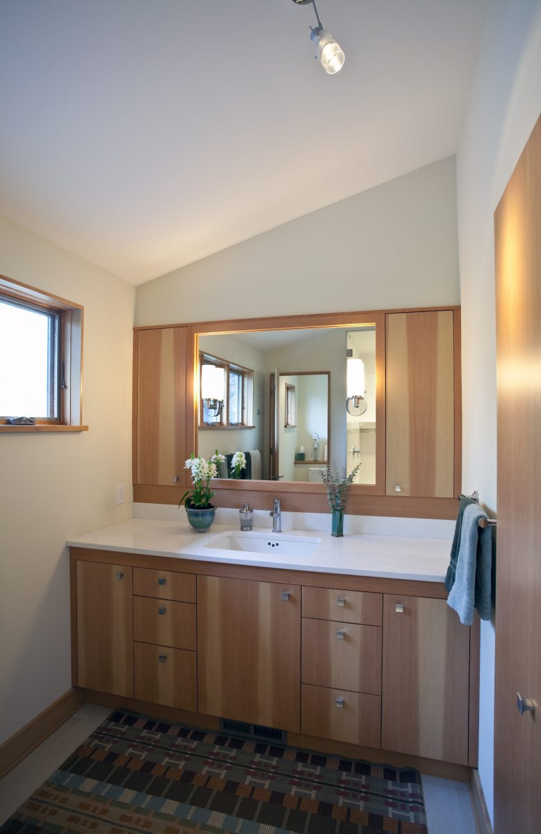 <p>The master bath was built as a part of the second-story master suite addition, and includes a heated tile floor, a steam shower, and a custom clear fir vanity.</p>