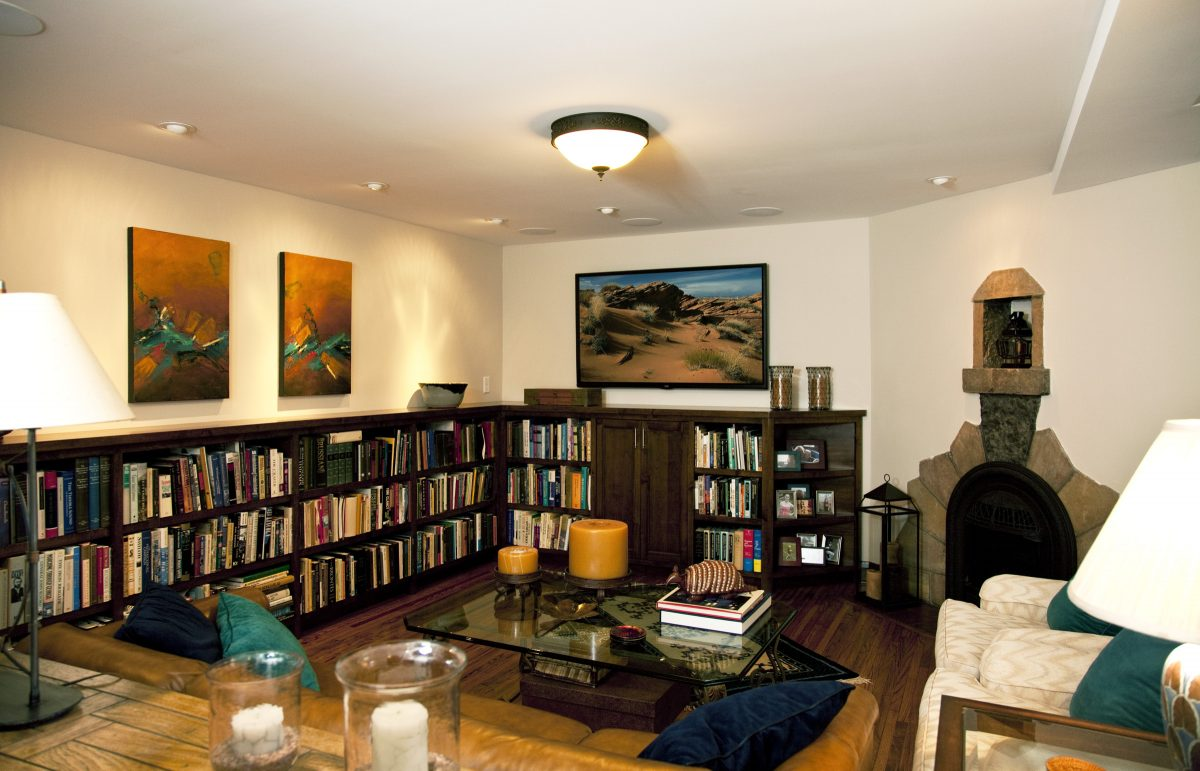<p>Prior to being remodeled, this basement was used as storage. TreHus refinished the hardwood floors and added built-in alder cabinets, a new entertainment area, improved lighting and in-ceiling speakers.</p>