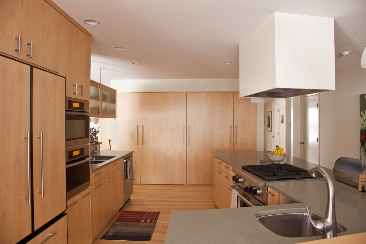 Located near the Mississippi river, bike paths and parks, the owners of this home wanted to update it to be as beautiful as its surroundings. The new kitchen features custom plain-sliced maple cabinets, an open layout, and a large island that offers maximum work space without making the space feel crowded.