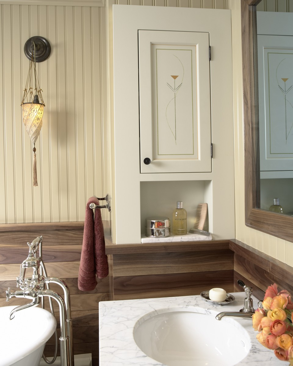 <p>Walnut wainscoting, beadboard, and carrera marble combine to make this a beautiful and unique bathroom. Every effort was made to create a feel of historic authenticity.</p>