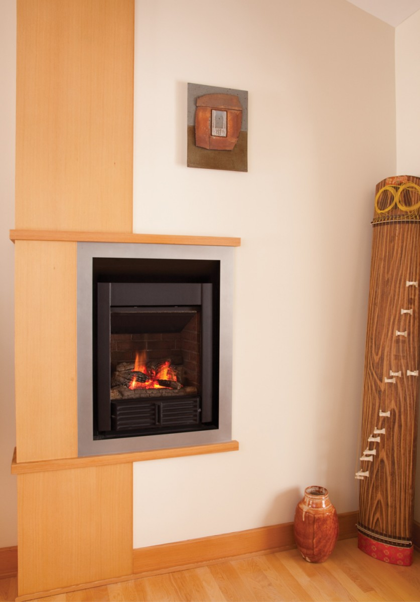 The fireplace is tied into the overall design with a fir surround, matching woodwork throughout the house.