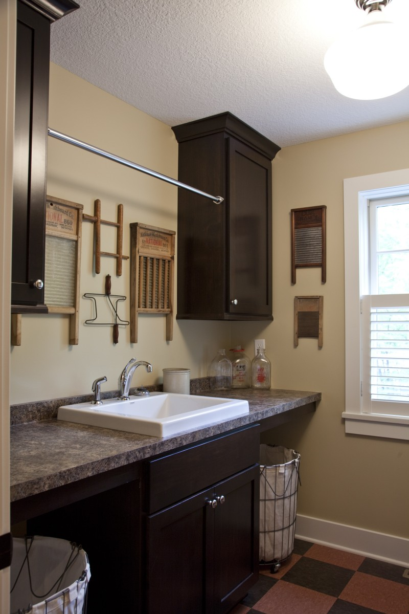 The laundry room is located on the upper level of the home so that the owners do not have to carry laundry up and down the stairs like in most homes. Because it is a working space, there were some places here where money could be saved – the countertop is laminate, and the floor is an inexpensive VCT tile.