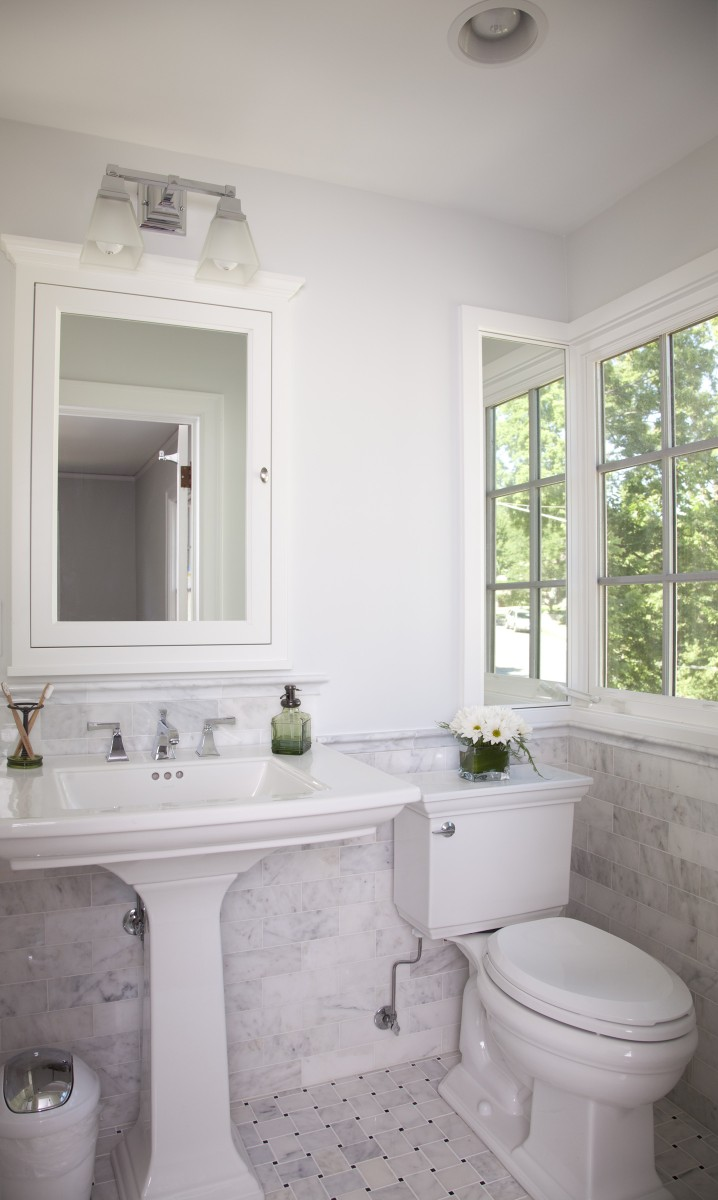 The exterior wall of the master bathroom was moved out 16″, making it a more comfortable size. Letoon wainscoting and a carrara marble basket weave pattern on the floor give this bath a rich aesthetic.