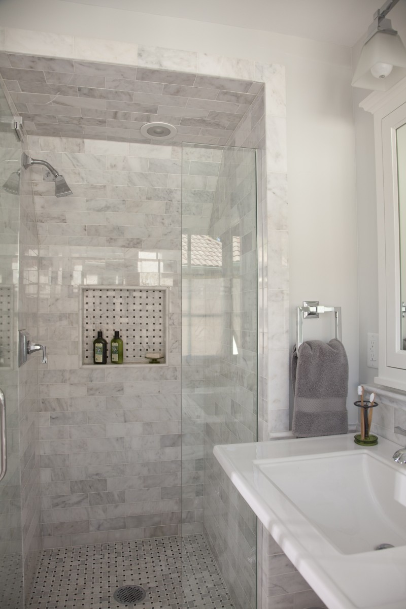 <p>The exterior wall of the master bathroom was moved out 16″, making it a more comfortable size. Letoon wainscoting and a carrara marble basket weave pattern on the floor give this bath a rich aesthetic.</p>