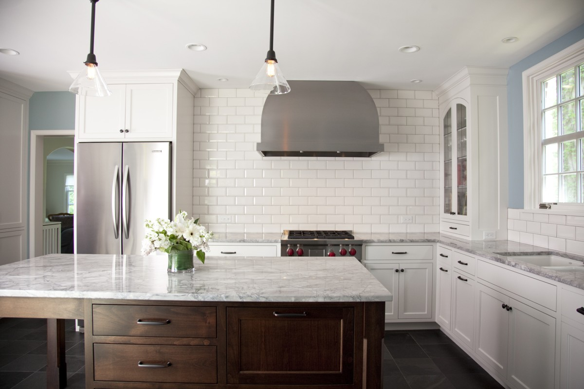Tiling the entire wall with beveled subway tile makes a dramatic statement.