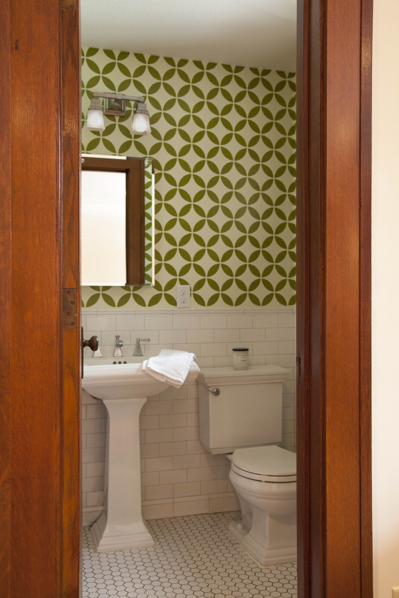 Custom stencil work ties the existing powder room into the new design.